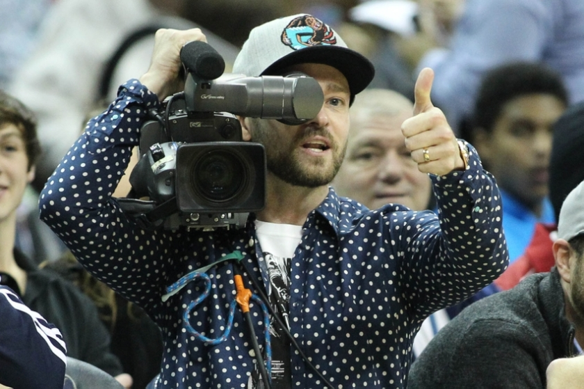Dec 7, 2014; Memphis, TN, USA; Memphis Grizzlies minority owner and entertainer Justin Timberlake holds the camera during a timeout in the first half of the game against the Miami Heat at FedExForum. Mandatory Credit: Nelson Chenault-USA TODAY Sports